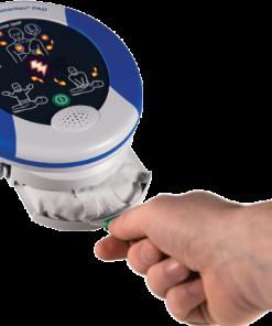 Hand Pulling Open The HeartSine Samaritan Defibrillator Pad