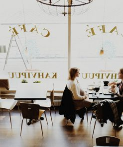 employees working together in a office space, collaborating on work